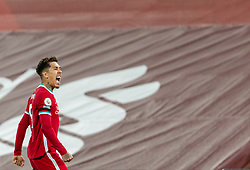 LIVERPOOL, ENGLAND - Wednesday, December 16, 2020: Liverpool's match-winning goal-scorer Roberto Firmino celebrates after scoring the second goal during the FA Premier League match between Liverpool FC and Tottenham Hotspur FC at Anfield. Liverpool won 2-1. (Pic by David Rawcliffe/Propaganda)