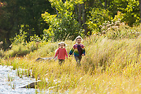 Children playing on shore of South Pond, Rolston Rest Project Property, VT