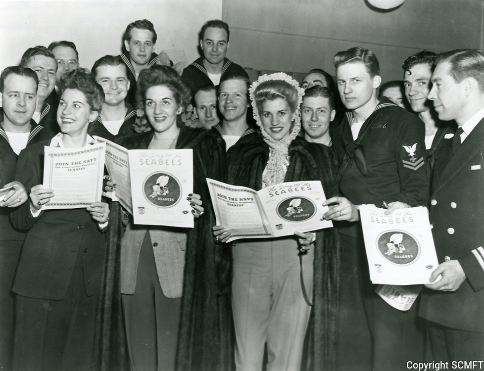 """1943 The Andrew Sisters, at the Hollywood Canteen, with sailors during the unveiling of the song """"The Song Of The Seebees"""""""