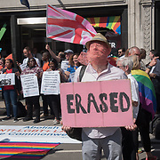 LGBT people protest against 70% of Commonwealth nations are bastions of homophobic prejudice, discrimination & violence and STOP persecuting LGBT people outside Marlborough House during Commonwealth Confrence Leaders meeting in London, UK.
