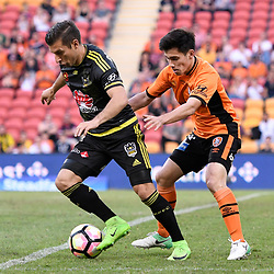BRISBANE, AUSTRALIA - APRIL 16: Kosta Barbarouses of the Phoenix and Joe Caletti of the Roar in action during the round 27 Hyundai A-League match between the Brisbane Roar and Wellington Phoenix at Suncorp Stadium on April 16, 2017 in Brisbane, Australia. (Photo by Patrick Kearney/Brisbane Roar)