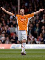 Photo: Daniel Hambury.<br />Brentford v Blackpool. Coca Cola League 1. 17/04/2006.<br />Blackpool's Peter Clarke celebrates his goal.