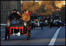 November 6, 2016 - London, London, United Kingdom - Image ©Licensed to i-Images Picture Agency. 06/11/2016. London, United Kingdom. ..The London to Brighton Veteran Car Run 2016...A 1903 Cadillac rear-entrance Tonneau leads a procession of vintage cars through Westminster, in central London, UK, on the first leg of the journey from London to Brighton...Picture by Ben Stevens / i-Images (Credit Image: © Ben Stevens/i-Images via ZUMA Wire)