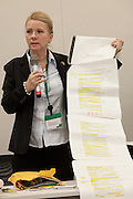 "Rape Survivor and activist, Catherine ""Jane"" Fisher shows a 6 metre long list of sexual crimes against women that have taken place in Okinawa since 1945 at a press conference to publicise her book in the First Office Building of the Members of the House of Representatives, Nagatacho, Tokyo, Japan, Friday July 18th 2014. Ms Fisher was raped near Yokosuka US Naval Base in Kanagawa in 2002 and has been campaign for the rights of rape victims in Japan since after finding the US Military and Japanese police obstructive and uninterested in bringing her attacker to justice."