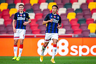 Middlesbrough defender Dael Fry (6) and Middlesbrough midfielder Marcus Tavernier (7) during the EFL Sky Bet Championship match between Brentford and Middlesbrough at Brentford Community Stadium, Brentford, England on 7 November 2020.