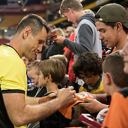 BRISBANE, AUSTRALIA - OCTOBER 7: Michael Theo of the Roar signs autographs during the round 1 Hyundai A-League match between the Brisbane Roar and Melbourne Victory at Suncorp Stadium on October 7, 2016 in Brisbane, Australia. (Photo by Patrick Kearney/Brisbane Roar)