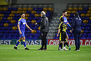 AFC Wimbledon manager Glyn Hodges with AFC Wimbledon defender Will Nightingale (5) after final whistle during the EFL Sky Bet League 1 match between AFC Wimbledon and Bristol Rovers at Plough Lane, London, United Kingdom on 5 December 2020.
