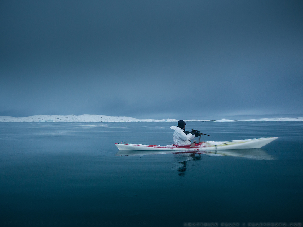 Going seal hunting on a kayak with hunter Magnus Eraksen. Life in and around the small Inuit settlement of Isortoq (population of 64), in East Greenland.