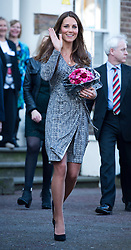 © London News Pictures. 19/02/2013. London, UK.  Catherine Duchess of Cambridge waving and carrying flowers as she leaves Hope House addiction centre for women in South London on February 19, 2013. The Duchess met clients and staff at Hope House, which is a 23-bed residential treatment centre for women with substance dependance. The Action Photo credit: Ben Cawthra/LNP