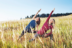 Oct. 11, 2014 - Mature women practising yoga on field (Credit Image: © Image Source/Image Source/ZUMAPRESS.com)
