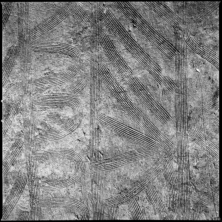 Benin - January 2009 - The patterns often resemble the patterns found on the walls of local buildings. The ceremony have a process of initiation is of great social importance and the rites of the ritual have special symbolic meanings. Scarification is used as a form of initiation into adulthood, beauty and a sign of a village, tribe, and clan.