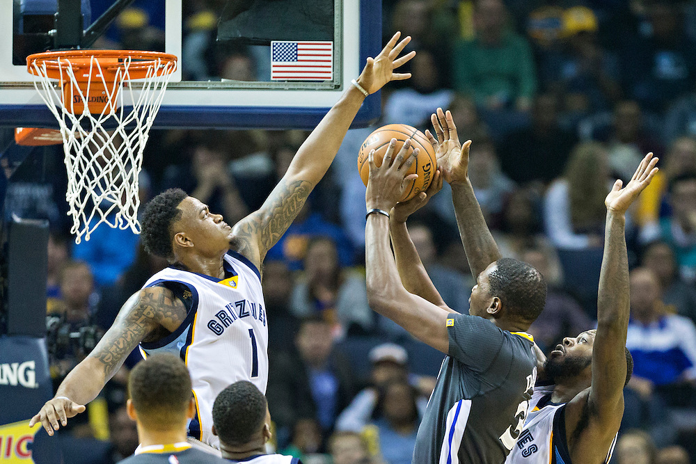 MEMPHIS, TN - DECEMBER 10:  Kevin Durant #35 of the Golden State Warriors goes up for a shot against Jarell Martin #1 of the Memphis Grizzlies at the FedExForum on December 10, 2016 in Memphis, Tennessee.  The Grizzlies defeated the Warriors 110-89.  NOTE TO USER: User expressly acknowledges and agrees that, by downloading and or using this photograph, User is consenting to the terms and conditions of the Getty Images License Agreement.  (Photo by Wesley Hitt/Getty Images) *** Local Caption *** Kevin Durant; Jarell Martin