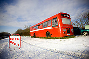 A wintry scene at The Red Bus cafe along the A1124 on the 18th December 2009 in Earls Colne in the United Kingdom. The Red Bus cafe is a converted bus serving commuters and traffic on the busy A1124 trunk road.