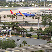 Southwest Airlines planes are seen on the tarmac at Orlando International Airport on Friday, April 17, 2020 in Orlando, Florida. (Alex Menendez via AP)
