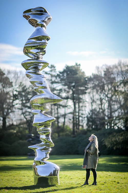 © Licensed to London News Pictures. 02/03/2017. Wakefield UK. Millie Carroll looks at Tony Cragg's sculpture Eliptical Column at Yorkshire Sculpture Park today. Tony Cragg's largest UK exhibition opens today at the Yorkshire Sculpture park, A Rare Category of Objects, the exhibition features more than 170 sculptures & works on paper drawn from nearly five decades of Cragg's practice, the exhibition demonstrates the artist's pioneering & continued mastery of materials.  Photo credit: Andrew McCaren/LNP