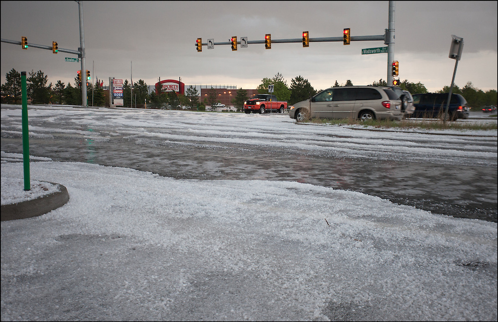 Denver, Colorado was blanketed in a hail storm produced by a tornado warned supercell.