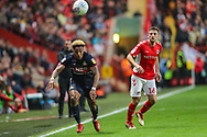 Doncaster Rovers forward Mallik Wilks (7) and Charlton Athletic defender Ben Purrington (16) during the EFL Sky Bet League 1 second leg Play-Off match between Charlton Athletic and Doncaster Rovers at The Valley, London, England on 17 May 2019.