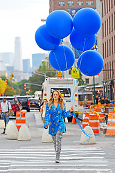 Rita Ora in a blue coat and over the knee boots carries blue balloons through Meatpacking as she films a music video. 05 Oct 2017 Pictured: Rita Ora. Photo credit: STB / MEGA TheMegaAgency.com +1 888 505 6342