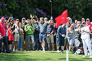 Piers Morgan celebrates to the crowd after a shot onto the 18th green during the Celebrity Pro-Am day at Wentworth Club, Virginia Water, United Kingdom on 23 May 2018. Picture by Phil Duncan.