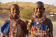 Maasai Women wearing and selling hand crafted, colorful jewelry at a border stop