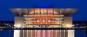 Ultra modern illuminated waterside Opera House by architect Henning Larsen in Copenhagen, Denmark
