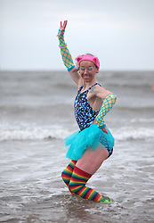 Licensed to London News Pictures. 01/01/2014. Whitley Bay, UK. Around a hundred swimmers braved an icy North Sea to take part in the annual Whitley Bay New Year dip, organised by the Panama Swimming Clun. Photo credit: Adrian Don/LNP
