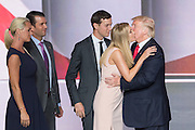 GOP Presidential candidate Donald Trump kisses his daughter Ivanka Trump as husband Jared Kushner looks on after accepting the party nomination for president on the final day of the Republican National Convention July 21, 2016 in Cleveland, Ohio.