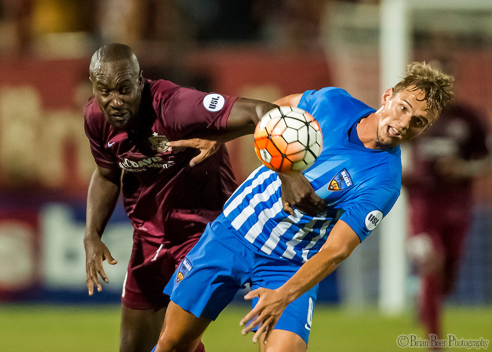 Sac Republic FC Carlton Cole (10), and Orange County Blues FC Maurice Pluntke (6), fight for position during the second half of the USL Western Conference first round playoff game between the Republic FC and the visiting Orange County Blues FC at Bonney Field, Saturday Oct 1, 2016.<br /> photo by Brian Baer
