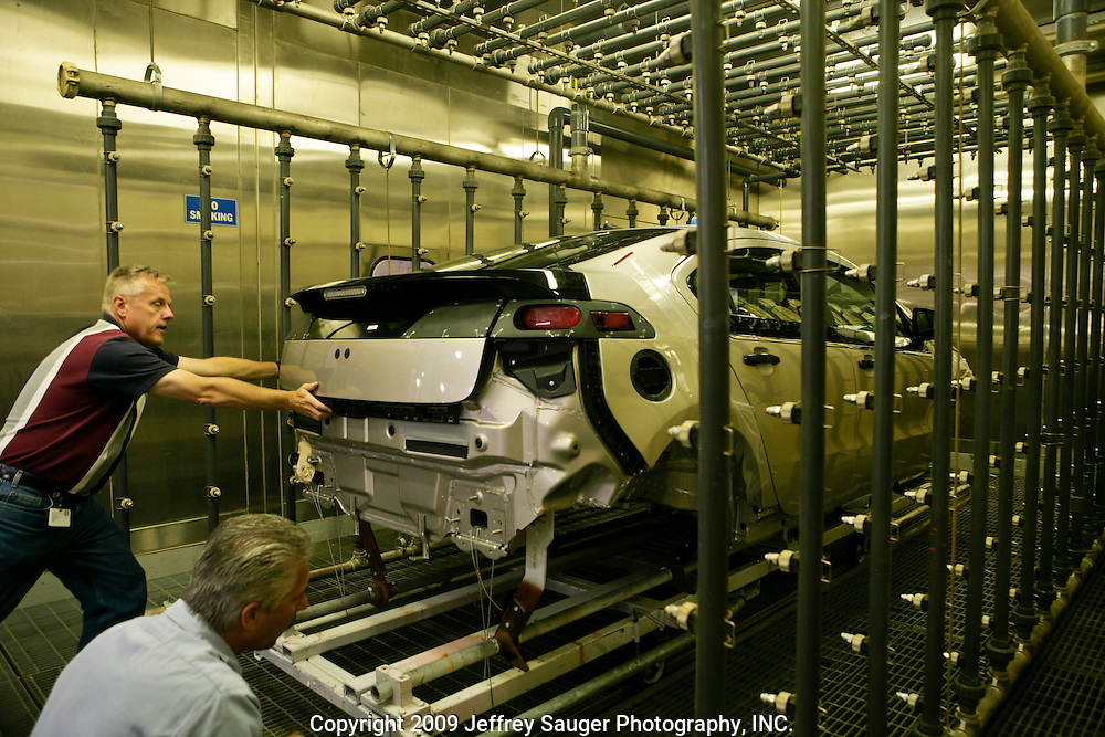 A pre-production Chevrolet Volt undergoes a water test at GM's Pre-Production Operations facility in Warren, MI, August 56, 2009. Executives and engineers from the Volt's Hamtramck assembly plant were also there learning about production requirements specific to the range-extended plug-in. (Jeffrey Sauger)