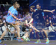 note : a multiple exposure image as Omar Mosaad of Egypt (wearing light Blue shirt) hits a shot against Mathieu Castagnet of France (wearing Black shirt). the Final, Omar Mosaad of Egypt v Mathieu Castagnet of France , Canary Wharf Squash Classic 2016 , at the East Wintergarden in Canary Wharf , London on Friday 11th March 2016.<br /> pic by John Patrick Fletcher, Andrew Orchard sports photography.