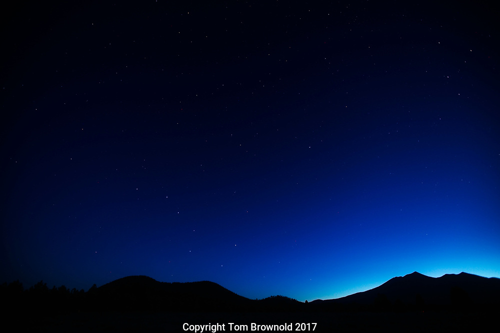 The big dipper and the N. star with the San Francisco Peaks at the navigational twilight of dawn.