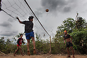 During a rest, KNLA soldiers play at ?Chinlone?..The ball is made of strips of woven rattan.