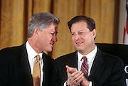US President Bill Clinton and Vice President Al Gore talk as they unveil the first balanced federal budget in the East Room of the White House February 2, 1999 in Washington, DC.