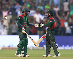 September 26, 2018 - Abu Dhabi, United Arab Emirates - Bangladesh cricketer Mushfiqur Rahim and Mohammad Mithun during the Asia Cup 2018 cricket match  between Bangladesh and Pakistan at the Sheikh Zayed Stadium,Abu Dhabi, United Arab Emirates on September 26, 2018  (Credit Image: © Tharaka Basnayaka/NurPhoto/ZUMA Press)