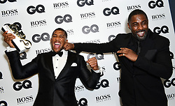 Anthony Joshua (left) with his Best Sportsman award poses with Idris Elba during the GQ Men of the Year Awards 2017 held at the Tate Modern, London.