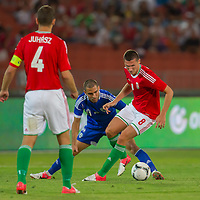 Hungary's Adam Gyurcso (L) watches as Israel's Eitey Menachem Shechter (C) and Hungary's Adam Pinter (R) fights fro the ball during a friendly football match Hungary playing against Israel in Budapest, Hungary on August 15, 2012. ATTILA VOLGYI
