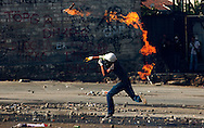 A protestor throws a molotov cocktail a riot police during clashes at Taksim Square Istanbul, Turkey, 11 June 2013. Turkey's crackdown on opposition protesters that reports said left at least two dead and more than 1,000 injured was 'truly disgraceful,' Amnesty International said 02 June, on a third day of the demonstrations. Demonstrations against the Islamic-conservative government of Prime Minister Recep Tayyip Erdogan began on 31 May when a police crackdown against a peaceful sit-in staged by environmentalists angered over a development project in Istanbul escalated into larger battles between law enforcement and demonstrators.