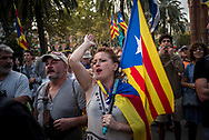 A woman reacts during a rally before the parlament section