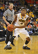 December 29 2010: Iowa Hawkeyes guard/forward Roy Devyn Marble (4) with the ball during the first half of an NCAA college basketball game at Carver-Hawkeye Arena in Iowa City, Iowa on December 29, 2010. Illinois defeated Iowa 87-77.