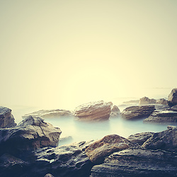 Inspired by polaroid instamatics, I decided to edit this image of Coogee beach around the cliff face like polaroid.