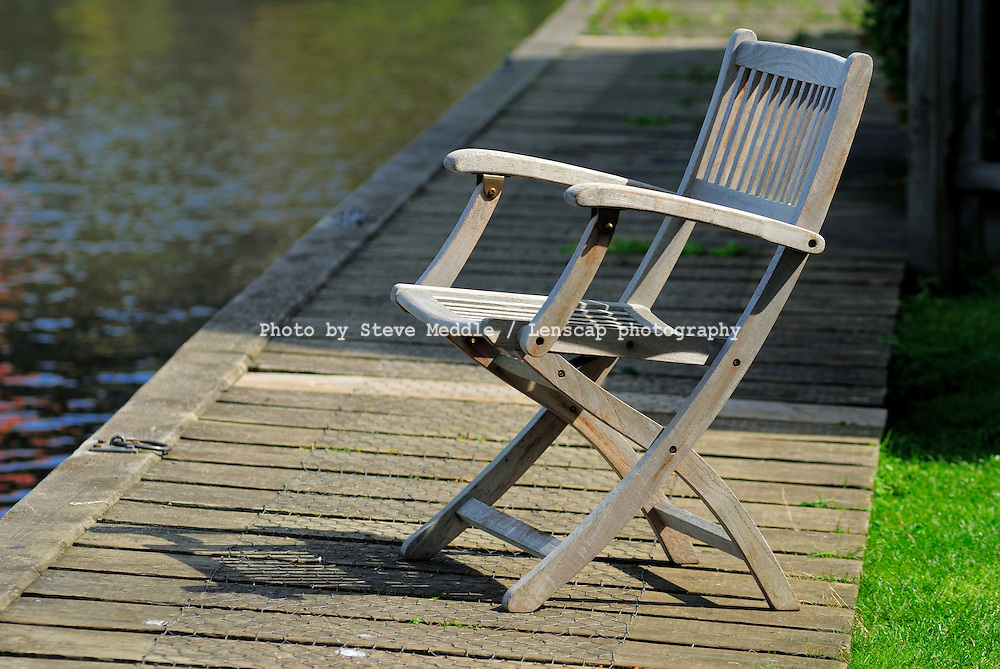 Empty Chair Beside Riverbank - Aug 2009
