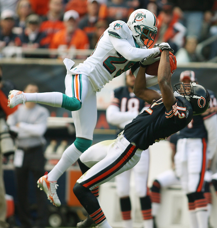 Chicago Bears vs Miami Dolphins at Soldier Field -- Miami's Andre Goodman, left, tries to grab a pass away from Chicago's Justin Gage (12) in the first quarter of the game.  The pass was ruled incomplete...