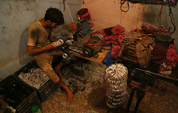 June 10, 2017 - Lahore, Punjab, Pakistan - Pakistani workers are busy preparing glass bangles at local factory for upcoming Eid ul Fitr. Bangles are rigid bracelets, usually from metal, wood, or plastic. They are traditional ornaments worn mostly by South Asian women in India, Pakistan and Bangladesh,Bangles are also known as Chura. Bengali: Churi, Choodi, Bangles are the most important women accessories for beautification which leads to a high demand before the Eid ul Fitr all over the world. (Credit Image: © Rana Sajid Hussain/Pacific Press via ZUMA Wire)