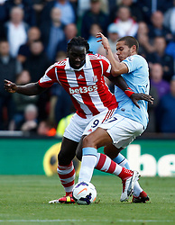 Stoke City's Kenwyne Jones battles with Manchester City's Jack Rodwell - Photo mandatory by-line: Matt Bunn/JMP - Tel: Mobile: 07966 386802 14/09/2013 - SPORT - FOOTBALL -  Britannia Stadium - Stoke-On-Trent - Stoke City V Manchester City - Barclays Premier League