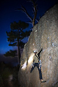 Jason Killgore climbs on The Dome at night in Boulder Canyon, outside Boulder, Colorado.