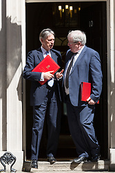 © Licensed to London News Pictures. 26/05/2015. London, UK. Philip Hammond and Patrick McLoughlin chat as they leave Downing Street in London after a cabinet meeting. Photo credit : Vickie Flores/LNP
