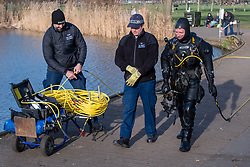 © Licensed to London News Pictures. 09/03/2021. London, UK. A Metropolitan Police Service Underwater and Confined Spaces Search Team diver and colleague walk next to Mount Pond in Clapham Common during the ongoing search for missing person Sarah Everard. Photo credit: Peter Manning/LNP