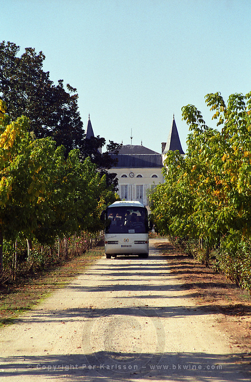 The entrance to the chateau grounds:  with a small gravel road leading up to the chateau, a bus driving on the road with visitors  Chateau Caillou, Grand Cru Classe, Barsac, Sauternes, Bordeaux, Aquitaine, Gironde, France, Europe