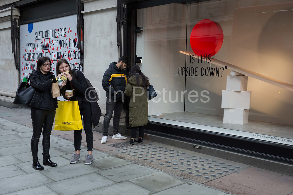 A shared sandwich outside a window display that is part of a design theme called State of the Arts, at the Selfridges department store on Oxford Street, on 4th March 2019, in London England. State of the Arts is a gallery of works by nine crtically-acclaimed artists in Selfridges windows to celebrate the power of public art. Each of the artists are involved in creating a site-specific artwork at one of the new Elizabeth line stations as part of the Crossrail Art Programme.