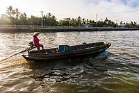 Boating to the Cai Rang Floating Market, Mekong Delta, Vietnam.